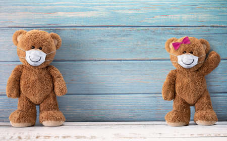 Cute teddy bears smiling behind the mask have a happy face for social distancing concept. with copy space.