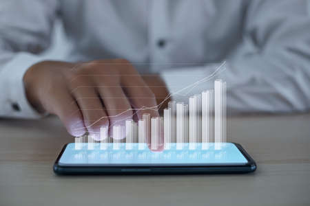 Business people analyze financial charts growth and success increase in business profits with smart phone screen display 3D AR Stock Photo