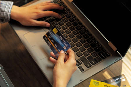 Business women use computer And credit card payment through online stores. Online banking concept