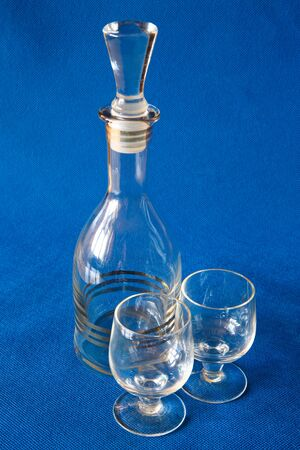 blue background: Glassware for alcoholic drinks.