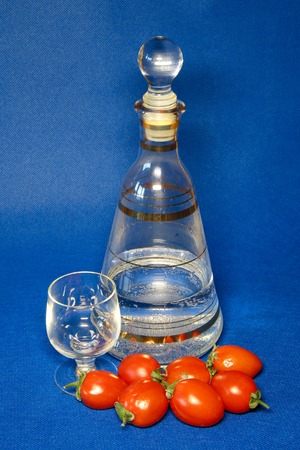 background blue: Decanter and glass, and tomatoes. 2