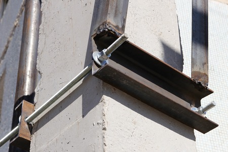 metal structure: The metal structure on a concrete pile. Stock Photo