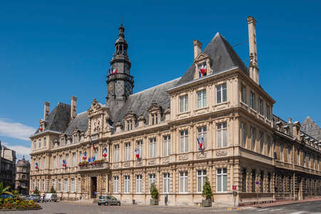 ville: Reims Hotel de Ville with French flags flying for Bastille Day Editorial