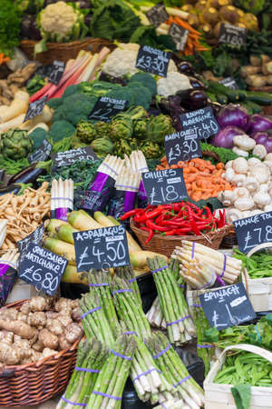 priced: A selection of vegetables priced up and displayed on a market stall Stock Photo