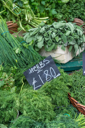grocers: A display of various herbs on a market stall