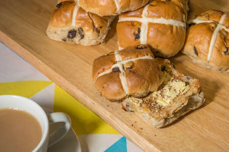 celebratory event: Hot cross buns with a cup of tea