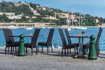 brasserie: A pair of bistro tables on the harour edge with yachts in the background