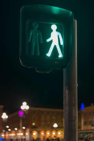 pedestrian crossing: Pedestrian crossing in France showing a green cross now light