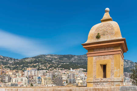 turrets: Monaco with a tower and the wall of the old city in the foreground Stock Photo