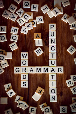 spelled: The words GRAMMAR WORDS and PUNCTUATION spelled  using letter tiles in the style of a crossword
