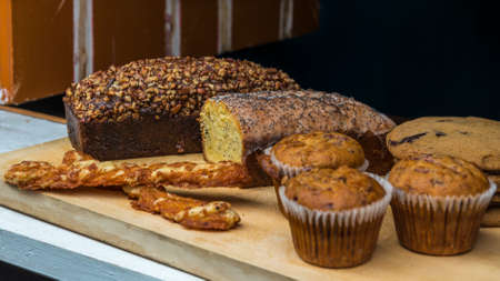 appetising: Breadsticks, cakes, muffins, and cookies on display