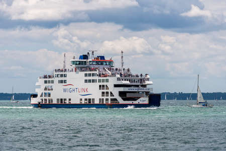 portsmouth: PORTSMOUTH, UK - JULY 25: A Wight Link car ferry sailing across the Solent between Portsmouth and the Isle of Wight shown on July 25, 2015 in Portsmouth, UK
