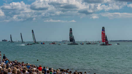 america's cup america: PORTSMOUTH, UK - JULY 25: The Team Emirates, Land Rover BAR, Groupama, Team Oracle, and Softbank Americas Cup boats sailing in the Americas Cup World Series qualifiers in Portsmouth shown on July 25, 2015 in Portsmouth, UK