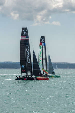 oracle: PORTSMOUTH, UK - JULY 25: The Team Oracle and Groupama Americas Cup boats sailing in the Americas Cup World Series qualifiers in Portsmouth shown on July 25, 2015 in Portsmouth, UK