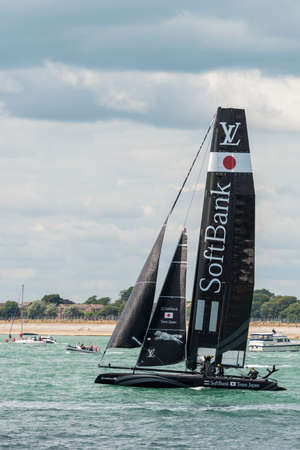 americas: PORTSMOUTH, UK - JULY 25: The Japanese Softbank Americas Cup boat sailing in the Americas Cup World Series qualifiers in Portsmouth shown on July 25, 2015 in Portsmouth, UK