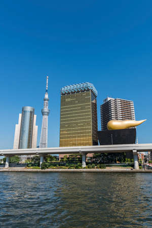 Tokyo skyline along the Sumida River including landmarks such as the Skytree and the Asahi headquarters Editorial