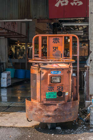A well used motorised cart used for transporting fish in the Tsukiji wholesale fish market Editorial