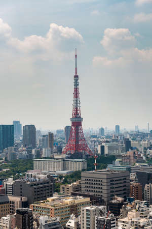 The Tokyo Tower rises above other buildings