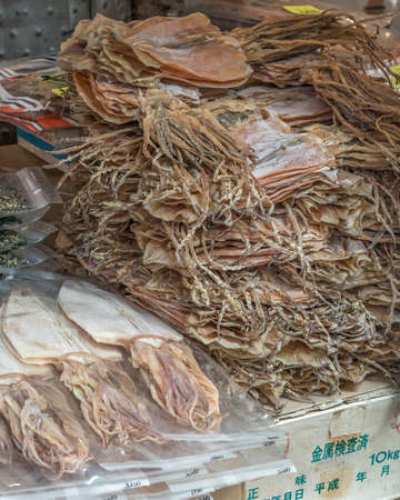 stacked up: Dried squid stacked up on a market stall in Japan Stock Photo