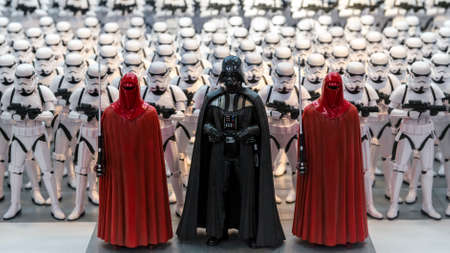 Minature model figures of Darth Vader and an army of storm troopers lined up in a display illustrating the Starwars films
