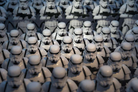 An army of miniature model Stormtrooper figures lined up in a display illustrating the Starwars films
