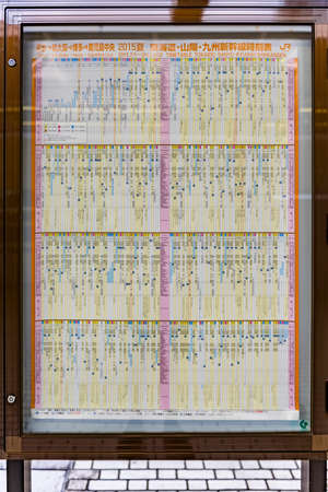 A complex Tokaido line timetable on a platform in Tokyo station Editorial