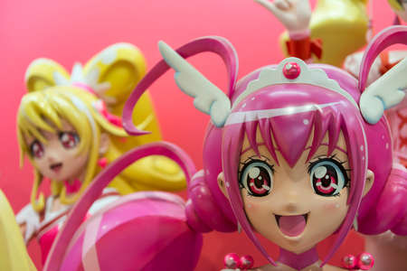 A large 3D model of a colourful Japanese anime girl character in a display