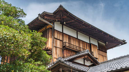 A traditional style Japanese wooden building with a tile roof