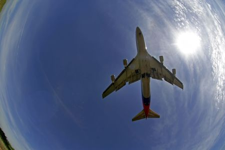 departing: A fisheye view of a Boeing 747-400 series in landing mode.