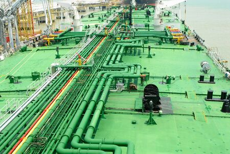 wetness: Petroleum pipes on a vessel Stock Photo