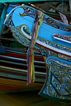 A colorful front of a boat.