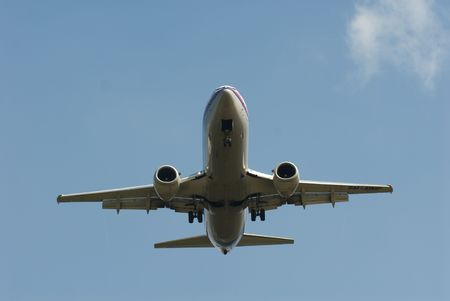 airfield: Stockphoto of an airplane landing on an airfield