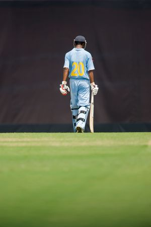 icc: A cricket batsman walking after hitting a ball. Stock Photo