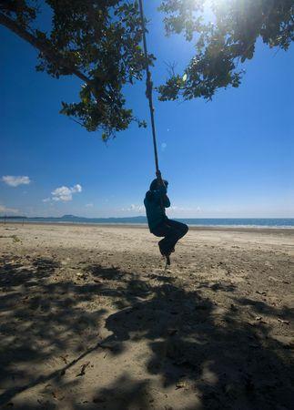 Kid recreation activity on sunny beach in Pahang, Malaysia. photo