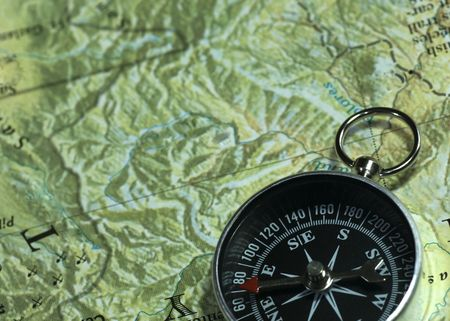 High up view of compass on map.