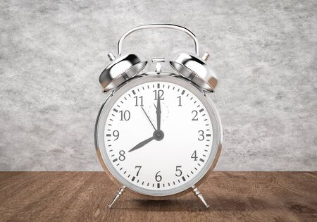 Alarm clock on wooden table and cement background, 3d rendering