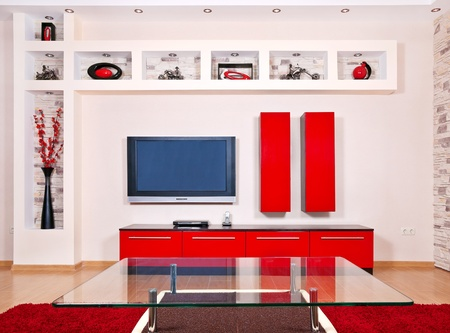 Beige and red interior of modern house with flat TV set