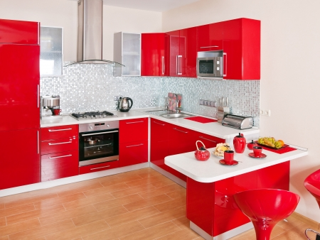 RENOVATE: Modern kitchen interior with red decoration  Stock Photo