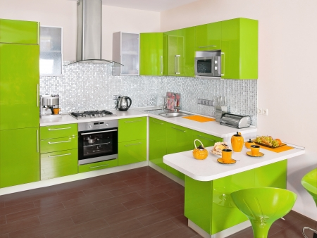 Modern kitchen interior with green decoration  photo