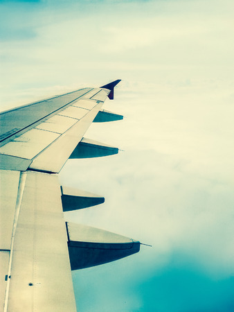 airplane window: looking through window aircraft in wing aerial view of landscape and sky vintage