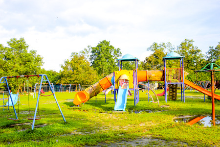 playground park on grass near school is children photo