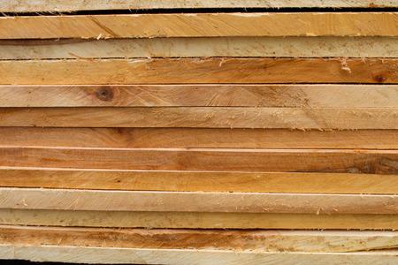 pile of sawed wood planks photo