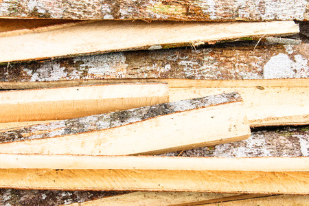 pile of sawed wood planks photo