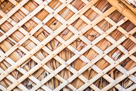 bamboo cross thatched straw roof photo
