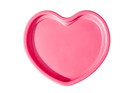 pink heart shaped plastic box isolated on white background photo