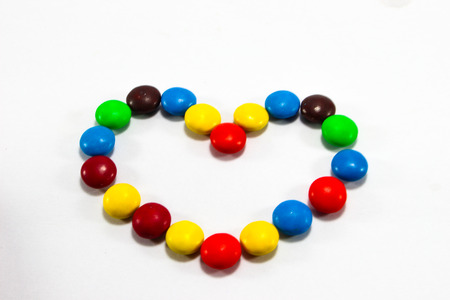 colorful candy hearts on a white background. photo