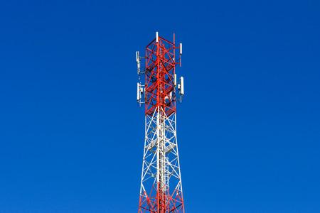 telephone pole telecommunications tower on blue sky background photo