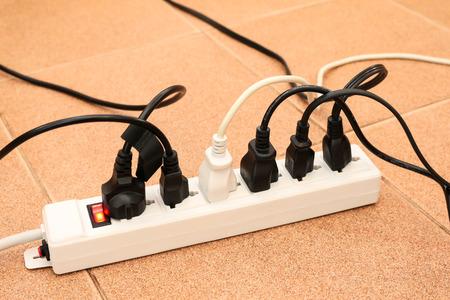 overloaded: overloaded power boards outlet multiple socket electrical plug