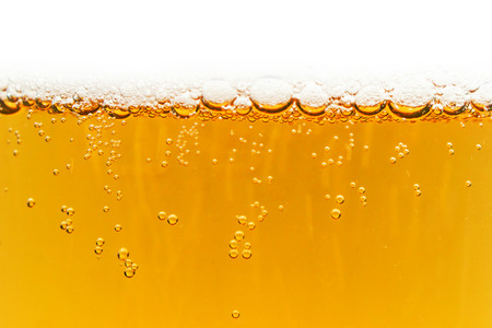 foam bubbles mug of beer texture background photo