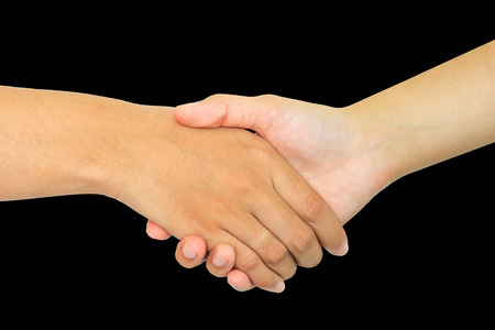 two persons shaking hands on black background